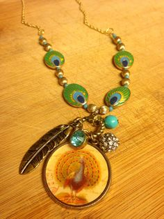 Peacock Charm Necklace by SaritaCreates on Etsy #jewelry #artisan #necklace #charms #beads
