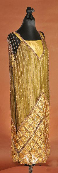 An olive-green sheath with sequin details, circa 1920s, University of Missouri Department of Textile and Apparel