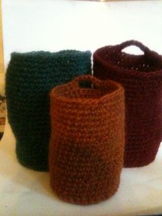Hand knit vessels, made with 100% wool. They're now being felted in the washing machine. Can't wait to see how they look.