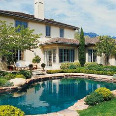 French Countryside Style...love the pool and the landscaping is so beautiful and natural looking.