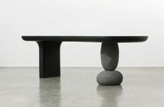 Furniture with natural stone base - Byung-Hoon Choi. Inspired by the megalithic stones, this bench is modern and sleek while still holding on to its historic inspired roots.