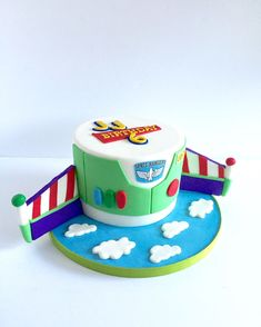 Buzz Lightyear tall round, wings are sculpted out of fondant Name badge and space ranger logo is an edible image Toy Story Birthday Cake, 3rd Birthday Cakes, 2nd Birthday Parties, Birthday Fun, Birthday Ideas, Cumple Toy Story, Festa Toy Story, Toy Story Theme, Toy Story Party