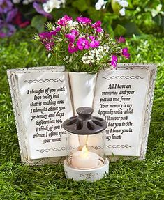 Remember a lost loved one with this Garden Memorial Book and its heartfelt engraved message. The cold cast ceramic book has a vase in the middle for their favorite flowers. The glass candleholder comes with an LED tea light candle to light your own etern