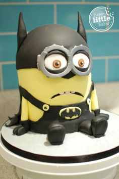 Batminion!  Batman themed Minion Cake Made for my little minions.  Followed The Royal Bakery minion tutorial but adapted it for the Batman theme.  Had a few tearful moments as his goggle cracked & there were a few pesky air bubbles under the fondant but my children love him.