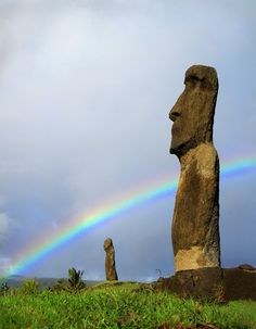 via www.mountainadventures.com  Easter Island. Right place, right time to catch the rainbow behind a mystical moai.