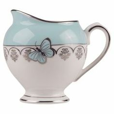 Add a charming touch to afternoon tea with this china milk jug, featuring a butterfly design.  Product: Milk jugConstruction Material: ChinaColour: Mint and silverDimensions: 18 cm H x 12 cm Diameter Cleaning and Care: Hand wash only