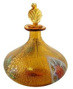 Murano Glass Perfume Bottle: murano is one of the islands in the Venice lagoon.  Hundreds of years ago all kilns were moved out there, away from Venice, for fear of fires. Murano still produces amazing art glass.