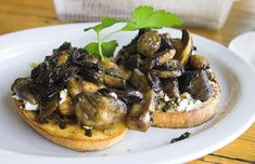 Mushroom Baguettes Bruschetta - Pesto Spread as base on bread with Goat Cheese as second layer below sauteed Mushrooms and Onions