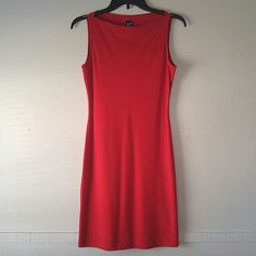Cute red dress, size medium Size medium, red dress with matching jacket. Bought a few years ago and have never worn it. Still has tags. Approximately 27 inches from armpit to bottom of dress. Polyester, rayon, and spandex. Very comfy material. Per Seption Dresses