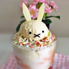 Liven up your desserts with some bunny ears! Strawberry and orange ice cream parfait with adorable chocolate details.