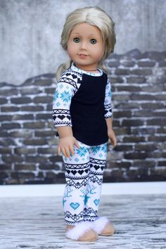 White, black, and teal snowflake leggings by Closet4Chloe on Etsy. Made following the LJC Leggings pattern, found here http://www.pixiefaire.com/products/leggings-18-doll-clothes. #pixiefaire #libertyjane #leggings