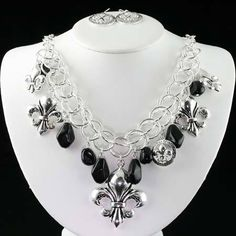 NEW! BEAUTIFUL   FLEUR DE LIS NECKLACE AND EARRING SET .  COLORS ARE  BLACK AND SILVER.  REALLY PRETTY SET!!