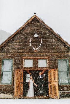 You don't have to step outside for a wedding picture with the snow | @benjhaisch | Brides.com