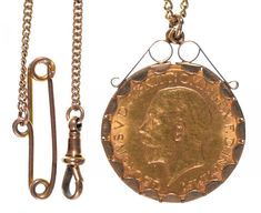 GOLD COIN. SOVEREIGN 1931SA, MOUNTED IN A 9CT GOLD PENDANT, ON GOLD NECKLET, 12.2G  Sold @ Mellors & Kirk