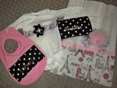 Personalized 5 Piece Baby Girl Paris Pink, White, and Black Gift Set - Onesie, Burp Cloth, Wipe Case, Hairbow, and Bib - Eiffel Tower. $37.50, via Etsy.