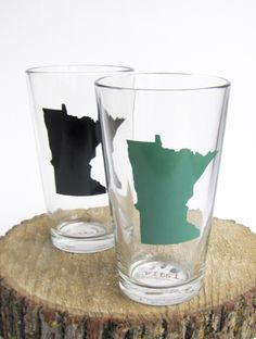 Screen-printed pint glass featuring a silhouette of Minnesota Hand printed