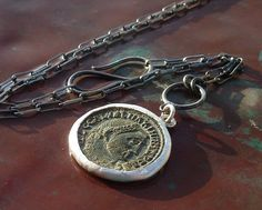 ancient Roman coin on a silver chain (as an Art History major - love)