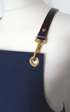 Handmade in London. Canvas apron with English leather straps. 12oz cotton canvas. English leather straps with hand finished edges. Solid brass spring clips. Two large hip pockets, with...
