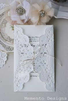 bridal shower idea - tying the doily paper with a little ribbon!