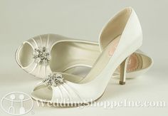 Kiss by Paradox London is a pair of beautiful dyeable wedding shoes made of luxurious dyeable White Satin with a 3 inch heel, an open inside of the foot, and a peep toe with light ruching and a beautiful beaded, rhinestone brooch in the center. (Looks like a nice shoe that's not too high)