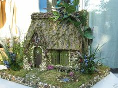Port Meadow Cottage Fairy House:  http://www.etsy.com/listing/51227284/port-meadow-cottage-fairy-house-custom