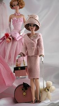Marie Therese in pink suit by Miniature Couture. Poodle is by Randall Craig and…