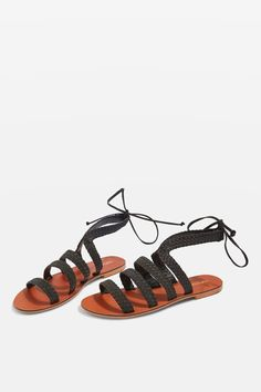 Opt for simple summer style with our black woven sandals. Pair with a floaty summer dress or slim-fit jeans.