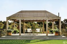 A cedar pergola provides an ideal spot for watching the action on the nearby tennis court