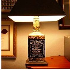 * would be awesome in the gameroom/man& cave* DIY Lamp. I made one of these using a demo wine bottle and it turned out great! Just buy the bottle lamp kits at walmart! - Eric would love this in his man cave Jack Daniels Lampe, Jack Daniels Bottle, Jack Daniels Soap Dispenser, Garrafa Diy, Diy Bottle Lamp, Bottle Bottle, Man Cave Diy, Man Cave Lamps, Lampe Decoration