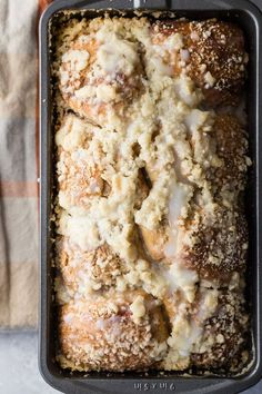 A yummy cinnamon and brown sugar breakfast bread topped with a buttery crumble topping. This bread is perfect toasted and spread with butter or Nutella. #bread #homemadebread #breakfastbread #cinnamonbread