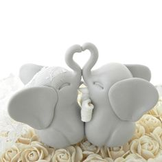This is the most adorable pair of light grey Elephants! She is wearing a beautiful lace veil and the groom is wearing a white bowtie. These guys are so cute! Their trunks form a heart. Did you know elephants mate for life? These beautiful Elephants will add so much sweetness to your beautiful cake! After the ceremony they can become part of your home decor and the perfect keepsake of your perfect day.