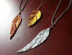 """how to make """"copper, gold, silver"""" feather pendants out of chocolate wrappers and a little oragami"""