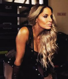 Trish looks like she's ready to teach these young guns what a real female wrestler looks like