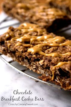 Chocolate Breakfast Cookie Bars - delicious chewy chocolate bars that are packed with crunchy cereal and oats. Drizzle with peanut butter for even more flavor! Oatmeal Chocolate Chip Cookie Recipe, Chocolate Recipes, Chocolate Bars, Chocolate Heaven, Breakfast Bake, Breakfast Cookies, Peanut Butter Drizzle Recipe, Delicious Desserts, Yummy Food