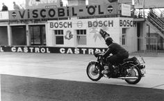 Anke-Eve Goldmann on BMW R69 practising at Nürburgring race circuit, ca. 1957