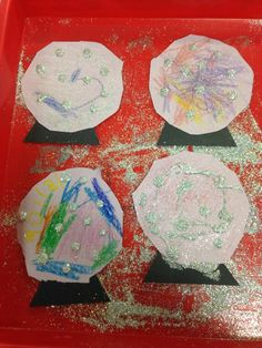 Snow Globes we made for weather week, the children really enjoyed this activity. They cut out their circles they decorated them winter like and then we did glue dots and we shook on glitter :)