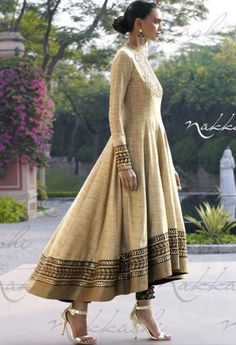 This glittering textured khadi fabric anarkali dress is in beige color. The yoke portion of the suit Anarkali Dress, Anarkali Suits, Anarkali Churidar, Punjabi Suits, Kurta Designs, Indian Attire, Indian Wear, Pakistani Outfits, Indian Outfits