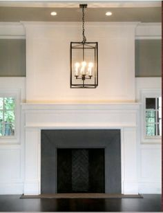 Dark Grey tile on inside of fireplace. Still deciding what colour tile I should use. Decisions, decisions....