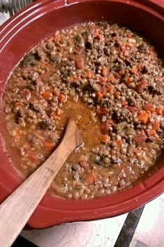 ... chicken stock, canned tomatoes, and drained lentils, cover, and bring