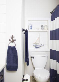 nautical Bathroom Decor I love all of the accessories and decor ideas in this nautical bathroom makeover! Nautical Bathroom Decor, White Bathroom Decor, Bathroom Kids, Simple Bathroom, Bathroom Interior Design, Master Bathroom, Bathroom Theme Ideas, Nautical Bathroom Accessories, Whale Bathroom