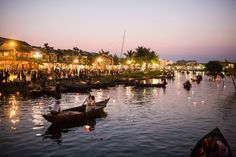 A romantic boat ride with a panoramic view over the lantern lit Hoi An old town.