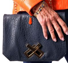 Barbara's blue bag is from TJ Maxx and her unique gold bracelets are estate pieces. (Allison Carey/The Plain Dealer)