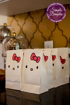 DIY white paper lunch bags to create Hello Kitty goodie bags. Get more inspiration for an adorable Hello Kitty themed party from Kitty Party, Hello Kitty Birthday Party Ideas, Birthday Ideas, Decoracion Hello Kitty, Anniversaire Hello Kitty, Hello Kitty Themes, Party Decoration, Party Bags, Party Favors