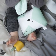 cuddly organic cotton cushions! OWL and RACCOON. mint and grey bedroom inspiration. FABELAB