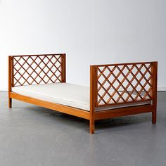 Joaquim Tenreiro, Brazil, 1960s  Daybed in pau maufim (ivory wood) with upholstered cushion.