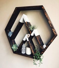 Essential oil hexagon wall shelf with added mountain peaks on the inside