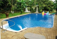 Outdoor Living Space Decoration With #RectangularOutdoorSwimmingPool.