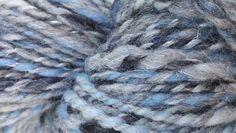 Stormy Skies (black/blue/gray) merino wool handspun yarn. $20.00, via Etsy.
