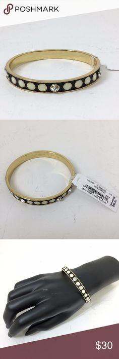 Kate Spade Idiom Rhinestone Bangle Bracelet Cute gold, black, and white bangle bracelet with 8 clear/silver rhinestones in circle pattern.  New with tags and original dust bag. kate spade Jewelry Bracelets