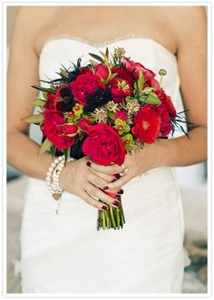 Red garden roses wedding bouquet